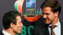 Le secrétaire général de l'Otan, Anders Fogh Rasmussen (à gauche) et le Premier ministre néerlandais Mark Rutte, à Lisbonne. L'Otan a confirmé vendredi être prête à entamer le transfert de la sécurité en Afghanistan aux forces afghanes dès l'an prochain,