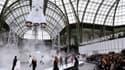 Une fusée durant le défilé Chanel le 7 mars 2017 à Paris