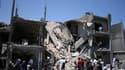 Immeuble résidentiel dans le quartier de Soul al Djouma à Tripoli, que les autorités libyennes présentent comme détruit par des frappes de l'Otan. Des responsables libyens ont affirmé dimanche que plusieurs civils avaient été tués lors d'un raid aérien me