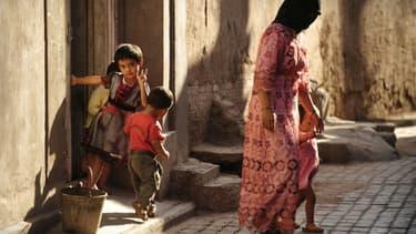Une famille ouïghoure à Kashgar dans le Xinjiang au nord-est de la Chine, le 10 juillet 2009.