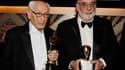 L'acteur Eli Wallach (à gauche), le réalisateur Francis Ford Coppola (à droite), ainsi que Jean-Luc Godard et l'historien du cinéma Kevin Brownlow, ont été honorés d'un Oscar pour l'ensemble de leurs carrières samedi soir à Hollywood. /Photo prise le 13 n