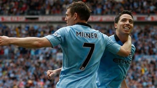 Le club de Manchester City, où évolue Samir Nasri (de face), pourrait dépenser près de 100 millions d'euros cet été.