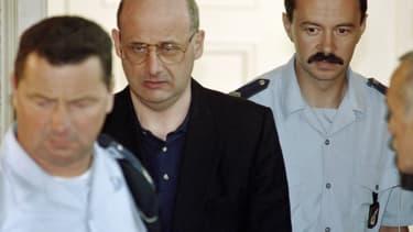 Jean-Claude Romand à son procès pour les meurtres de sa femmes, de ses enfants et de ses parents.