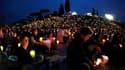 Des milliers de pèlerins ont participé samedi à une veillée de prière au Circus Maximus, avant la béatification de Jean Paul II lors d'une cérémonie prévue dimanche. /Photo prise le 30 avril 2011/REUTERS/Alessia Pierdomenico