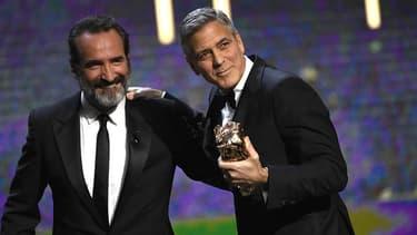 George Clooney et Jean Dujardin ce vendredi lors de la 42ème cérémonie des César.