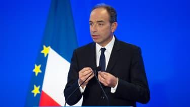 Jean-François Copé donnant une conférence de presse au QG de l'UMP à Paris, le 8 janvier 2014.