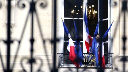 Les drapeaux, ici à l'Elysée, ont été mis en berne lundi  sur tous les édifices publics pour trois jours.