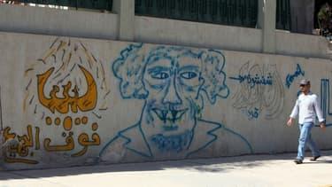Graffiti de Mouammar Kadhafi, à Syrte, le 13 octobre 2012.