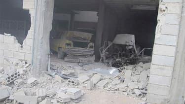 Correction: bien lire Bab Amro, et non Baba Amro. Maison endommagée dans le quartier de Bab Amro à Homs. Les bombardements de l'armée syrienne se sont poursuivis mercredi à Homs, foyer de la contestation du régime du président Bachar al Assad, et ont fait