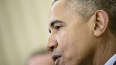 Barack Obama lors d'une conférence de presse dans le bureau ovale de la Maison Blanche