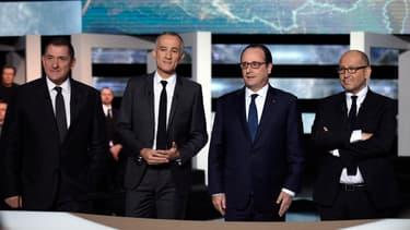 Thierry Demaizière (à droite de François Hollande), lors de l'émission face aux Français sur TF1,
