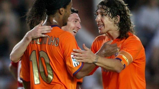 Carles Puyol, Ronaldinho et Lionel Messi