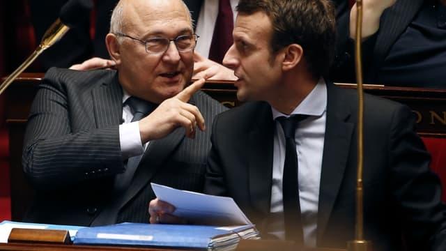 Michel Sapin - ici avec Emmanuel Macron - s'est félicité des chiffres du déficit public pour 2015.