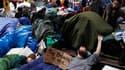 Les manifestants du mouvement Occupy Wall Street étaient déterminés vendredi à empêcher le nettoyage du campement improvisé où ils se sont installés il y a près d'un mois dans le district new-yorkais de Lower Manhattan, laissant présager une probable conf