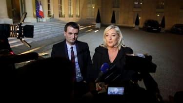 Marine Le Pen accompagnée par le vice-président du Front national Florian Philippot, à l'Elysée. Recue par François Hollande dans le cadre des consultations sur l'avenir des institutions, la présidente du FN a plaidé pour davantage de proportionnelle aux