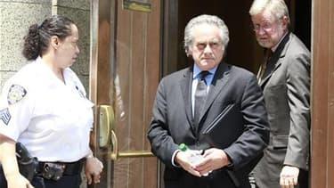 Les avocats de Dominique Strauss-Kahn, Benjamin Brafman (au centre) et William Taylor, après leur réunion avec les services du procureur mercredi. Selon le New York Times, les avocats de Dominique Strauss-Kahn ont indiqué qu'il n'y avait pas eu de discuss