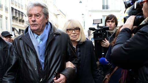 Alain de Delon et Mireille Darc se rendent à l'hommage donné en l'honneur du réalisateur Georges Lautner, le 5 décembre 2013.