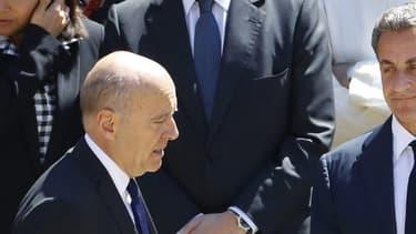 Nicolas Sarkozy et Alain Juppé aux Invalides le 7 juillet 2016.