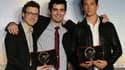 De gauche à droite: le compositeur américain Nicholas Britell, le réalisateur franco-américain Damien Chazelle et l'acteur américain Miles Teller.