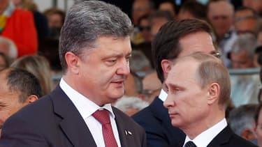 Les deux présidents Petro Poroshenko et Vladimir Poutine lors des commémorations du Débarquement, en France, le 6 juin dernier.