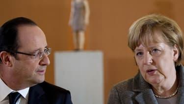 François Hollande et Angela Merkel vont tenter d'afficher l'unité du couple franco-allemand en adoptant une contribution commune pour le Conseil européen de juin, mais le coup de menton du président à l'adresse de Bruxelles brouille le message. /Photo pri