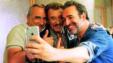 """Jean Dujardin, Johnny Hallyday et Antoine Duléry réunis dans """"Chacun sa vie"""" de Claude Lelouch."""