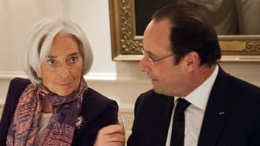 Christine Lagarde, ici avec François Hollande lundi à Washington, pourrait s'asseoir sur le siège initialement réservé à Valérie Trierweiler.
