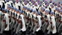 """Défilé du 1er régiment de Spahis, à l'occasion du 14 juillet à Paris. François Hollande a opposé samedi les jeunes de l'armée française, prêts a mourir pour leur pays, à ceux de l'équipe de France de football qui manqueraient selon lui de """"respect pour le"""