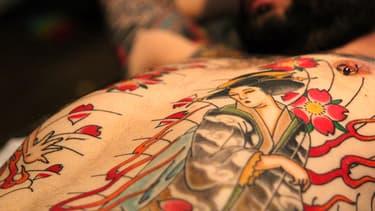 Au salon du tatouage, en mars 2014.