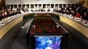 Nicolas Sarkozy et le Premier ministre finlandais Mari Kiviniemi, sur ècran, à l'occasion d'une réunion du 8e sommet Asie-Europe. Le président français a appelé lundi à la construction d'un nouvel ordre monétaire mondial susceptible de remédier aux déséqu