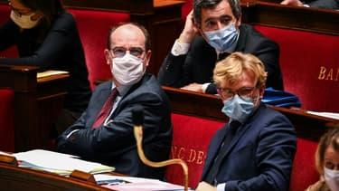 Au premier plan, Jean Castex et Marc Fesneau , devant Gérald Darmanin, à l'Assemblée nationale le 24 novembre 2020