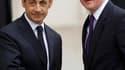 Nicolas Sarkozy et le Premier ministre britannique David Cameron à l'Elysée. Le président français a déclaré que l'opération militaire aérienne pour empêcher les forces de Mouammar Kadhafi de s'en prendre à la population libyenne avait commencé, mais la p