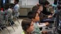 Des élèves de CM1-CM2 en cours d'informatique, aux Etats-Unis, en 2009.