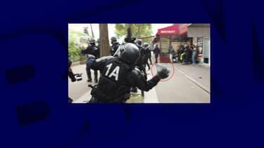 CRS le 1er mai lançant un pavé en direction de manifestant