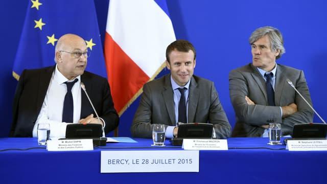Michel Sapin, Emmanuel Macron et Stéphane Le Foll, en 2015 à Bercy.