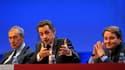 Nicolas Sarkozy aux côtés de Jacques Pélissard (à gauche), président de l'Association des maires de France et André Laignel, secrétaire général de l'AMF. Lors du 93e congrès annuel des maires de France, le chef de l'Etat a pressé les collectivités locales