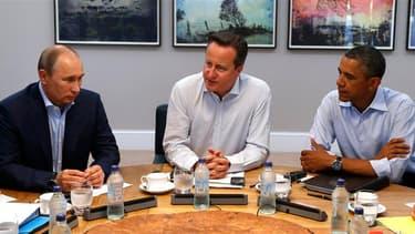 Vladimir Poutine, David Cameron et Barack Obama à Enniskillen, en Irlande du Nord. Au second jour du sommet du G8, le président russe s'est retrouvé mardi aussi isolé que déterminé sur le dossier syrien, malgré les pressions de ses partenaires pour qu'il