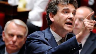 Arnaud Montebour et en arrière plan Jean-Marc Ayrault, le 17 juillet 2012 à l'Assemblée nationale.