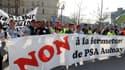 Manifestation de salariés du site PSA d'Aulnay-sous-Bois (Seine-St-Denis) à Paris, le 23 mars dernier.