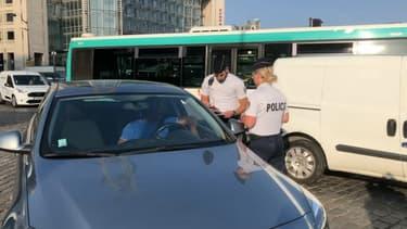 Des policiers lors d'un épisode de circulation différenciée en juin dernier