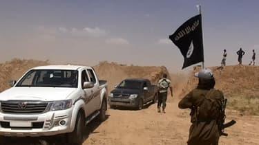 Un jihadiste Français a été arrêté au Maroc, suspecté de rallier la France pour recruter des candidats pour la Syrie. Ici, des jihadistes de l'EIIL, photo postée sur le compte twitter de Al-Barakanews le 11 juin 2014.
