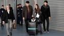 Des Français rapatriés du Japon à leur arrivée à l'aéroport de Roissy, ce mercredi.