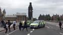 Des policiers près du pont de Westminster, le 14 août 2018.