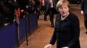 La chancelière allemande Angela Merkel à son arrivée à Bruxelles. L'hypothèse d'un nouveau traité réservé aux membres de la zone euro et aux pays qui souhaiteraient les rejoindre prend corps jeudi soir à l'ouverture du sommet européen de Bruxelles. /Photo