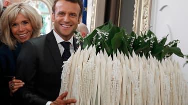 Emmanuel et Brigitte Macron lors du 1er mai 2019, au palais de l'Elysée.