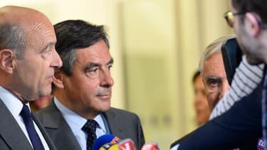 François Fillon et Alain Juppé devant le siège de l'UMP mardi 10 juin