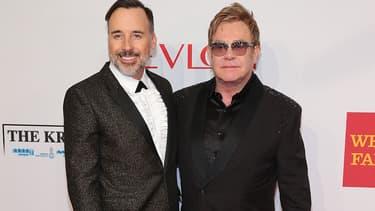 Elton John et son mari David Furnish. Ils sont parents de deux petits garçons nés d'une mère porteuse.