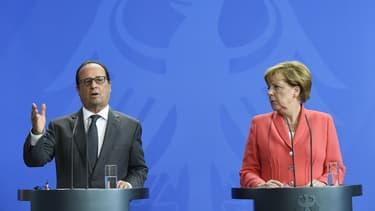 François Hollande et Angela Merkel veulent faire adopter une répartition obligatoire des demandeurs d'asile aux pays de l'Union européenne.