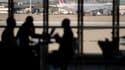 Des passagers dans l'aéroport d'Orly, image di'illustration.