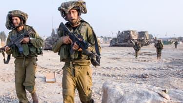 Des soldats israéliens reviennent de Gaza, le 23 juillet 2014.